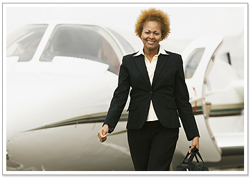 Executive Woman Leaving Jet