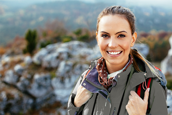 Woman Smiling While Hiking